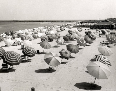 View of Cliffside Beach with umbrellas. Photograph by Louis Davidson. 1950s