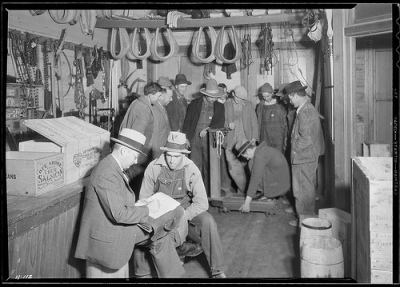 E. H. Elam, interviewer for the TVA, making personal interviews at Stiner's Store, Lead Mine Bend, Tennessee, with applicants for work on Norris Dam - 1933. The U.S. National Archives